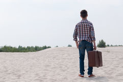 Stylish teenager on the beach. Stylish teen with suitcase on the beach Royalty Free Stock Photos
