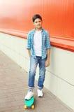 Stylish teenager boy riding on skateboard Stock Photos