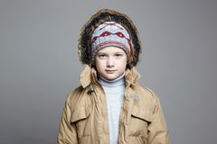 Stylish teenager in knitted hat and Hoodie royalty free stock image