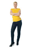 Stylish teenager posing with crossed arms Stock Images