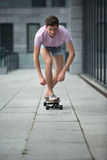 Stylish teenager riding a longboard Royalty Free Stock Photos