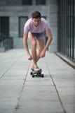 Stylish teenager riding a longboard Royalty Free Stock Photos