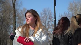 Stylish teenagers sings and dance in park. Funny friends sings and dances at the street in park. Teenagers have fun together and moving to the beat of music stock video