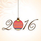 Stylish text 2016 with Xmas Ball for New Year celebration. Stylish text 2016 with hanging colorful Xmas Ball on floral decorated background for Happy New Year Stock Images