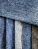 Stylish textured background frame from strips of denim in differ Stock Photography