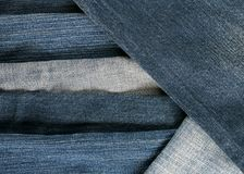 Stylish textured background frame from strips of denim in differ Stock Photo