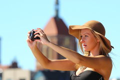 Stylish traveler woman with camera old town Gdansk Stock Photos