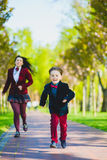 Stylish trendy boy and woman or son with mother playing outdoor Royalty Free Stock Image