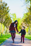 Stylish trendy boy and woman or son with mother playing outdoor Royalty Free Stock Photo