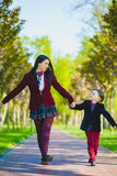 Stylish trendy boy and woman or son with mother playing outdoor Stock Photo
