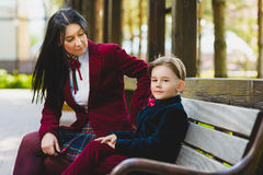 Stylish trendy boy and woman or son with mother posing outdoor Stock Photos
