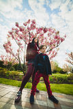 Stylish trendy boy and woman or son with mother posing outdoor Royalty Free Stock Image