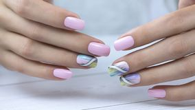 Stylish trendy female manicure. Beautiful Nail Art Manicure. Nail designs with decoration royalty free stock photography