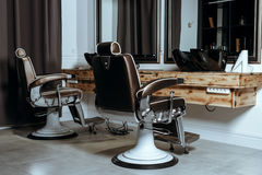 Stylish Vintage Barber Chairs. In Wooden Interior. Barbershop Theme Stock Photography