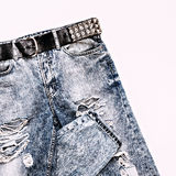 Stylish vintage blue jeans with metal strap. Rock style Stock Images