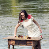 Stylish vintage girl with chess Stock Photography