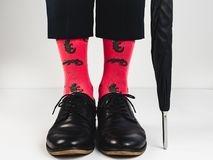Stylish shoes and bright socks stock images
