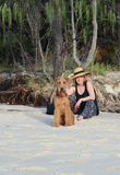 Stylish vogue mature senior woman on summer beach holiday with pet dog stock photo
