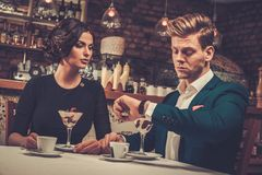 Stylish wealthy couple having desert and coffee together Stock Images