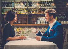 Stylish wealthy couple having desert and coffee together Royalty Free Stock Photo