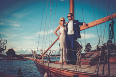Stylish wealthy couple on a luxury yacht Stock Photography