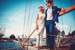 Stylish wealthy couple on a luxury yacht Royalty Free Stock Photos