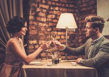 Stylish wealthy couple toasting with champagne Stock Photography