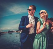Stylish wealthy couple on a yacht Stock Photos