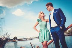 Stylish wealthy couple on a yacht Royalty Free Stock Photography