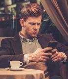Stylish wealthy man using mobile phone Royalty Free Stock Images