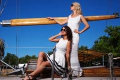 Stylish wealthy women on a luxury yacht Royalty Free Stock Image