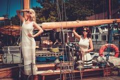 Stylish wealthy women on a luxury yacht Stock Photo