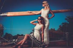 Stylish wealthy women on a luxury yacht Stock Photos