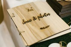 Stylish wedding book with a wooden cover. Stock Photos