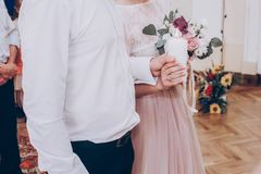 stylish wedding bride and groom holding big candle. modern couple with candle light, family tradition. romantic tender moment, o stock photography