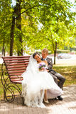 Stylish wedding couple  bride in white dress and Stock Images