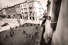 Stylish wedding couple kisses on the balcony in the old city stock photos