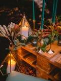 Stylish wedding decoration with candles, decor and floristic. Wedding dinner stock image
