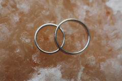 Stylish wedding rings on crystal stone top view. together foreve Royalty Free Stock Photo