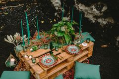 Stylish wedding table with candles, dishes and floristic. Wedding rustic dinner. Stylish wedding table with candles, dishes and floristic. Wedding dinner royalty free stock images
