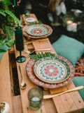 Stylish wedding table with candles, dishes and floristic. Wedding rustic dinner. Stylish wedding table with candles, dishes and floristic. Wedding dinner royalty free stock photos
