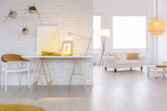 Stylish white apartment. With creative designed working space Royalty Free Stock Photography