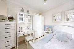 Stylish white bedroom with big bed, wardrobe
