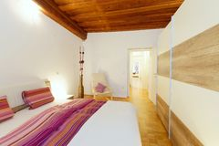 Stylish white bedroom Stock Photos
