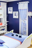 Stylish white-blue children room with original bed Royalty Free Stock Photography