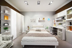 Stylish white-brown bedroom with double bed Stock Image