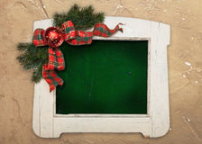 Stylish white colored wooden frame with christmas decoration Royalty Free Stock Photos