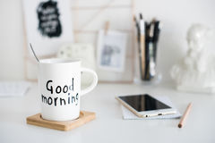 Stylish white desktop, home office interior details with coffee Stock Photos