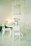 Stylish white dinner table Stock Photos