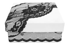 Stylish white gift box, decorated with exquisite black lace ribbon Stock Photos